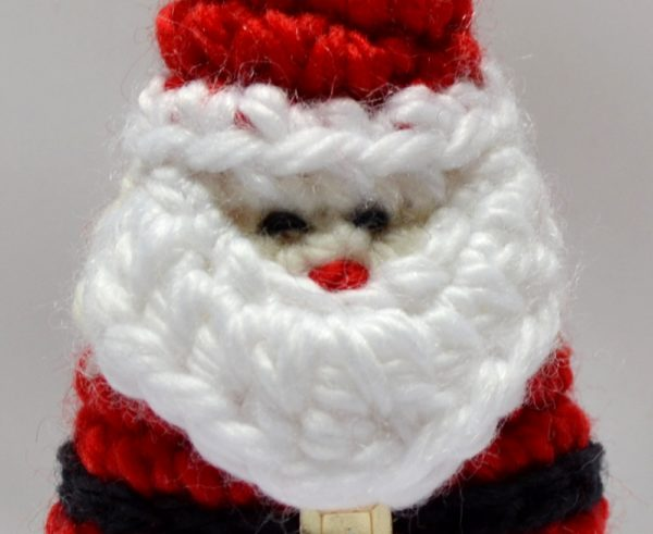 Close up of eyes crochet santa decoration
